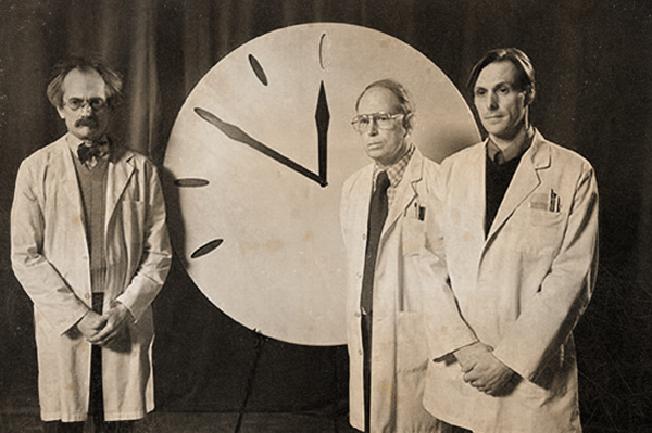 Scientists in front of the Doomsday Clock
